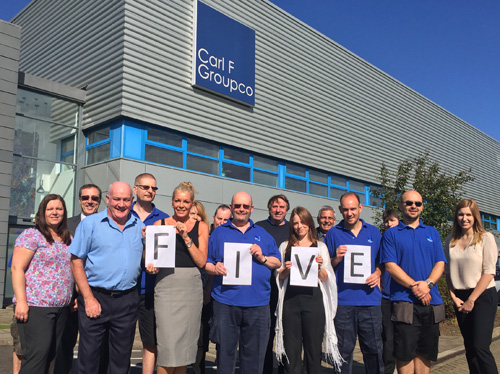 Members of Carl F Groupco's Peterborough workforce mark the fifth anniversary since the merger of Groupco and Carl F