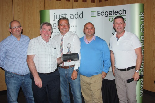 Alan Fielder (second left) presents the trophy to the winning team of Gareth Edwards, Synseal; Jeremy Kemp, Padiham Glass; Joe Hague, Promac and Andy Jones, Edgetech UK