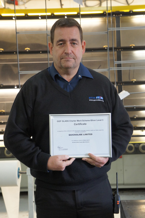 Quickslide's Michael Connor proudly displays the GGF GLASS Charter Merit Scheme certificate