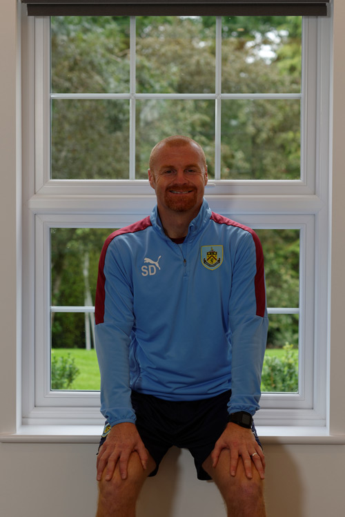 Sean Dyche with one of his new 'A' rated, fully sculptured windows from The Veka UK Group, fabricated and fitted by Glazerite and MG Windows respectively
