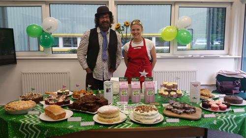 Kev Burrows and Lucy Forrester at Epwin Window Systems' charity coffee morning for Macmillan Cancer Support