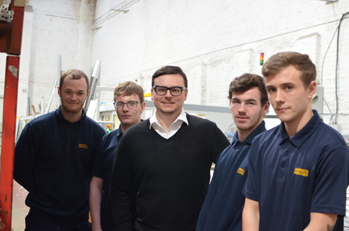 Director Greg Johnson (centre) with the apprentices