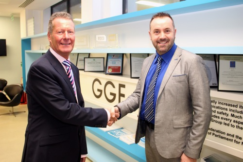 Outgoing President, Brian Baker (left), welcomes Andrew Glover as the new GGF President