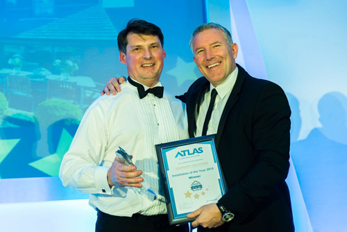 Paul Nellis of Orangery Solutions collecting the award from Gareth Thomas