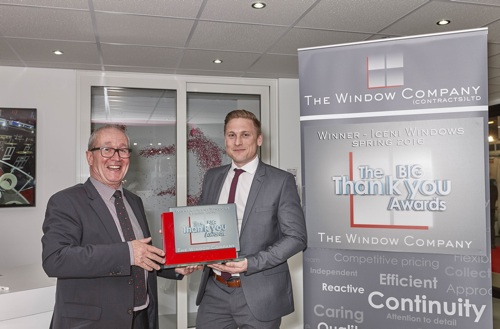 David Thornton (left) from The Window Company presenting the Big Thank You award to Paul Foyle from Iceni on the REHAU stand at FIT