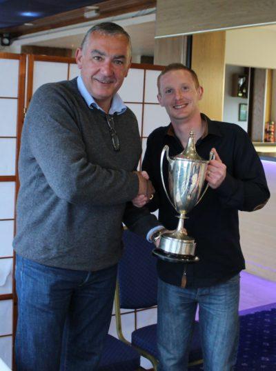 Alex Gray (left) presents winner James Thomson