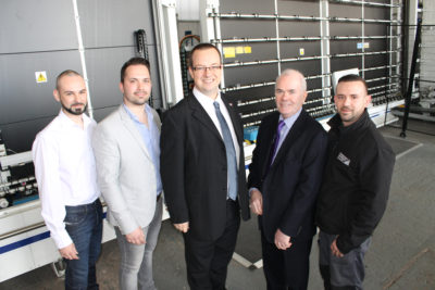Mike Wood MP with the ESG directors, opening their second high volume Super Spacer line (L-R Luke Walker, Alex Walker, Mike Wood MP, Ken Walker and Elliot Walker)