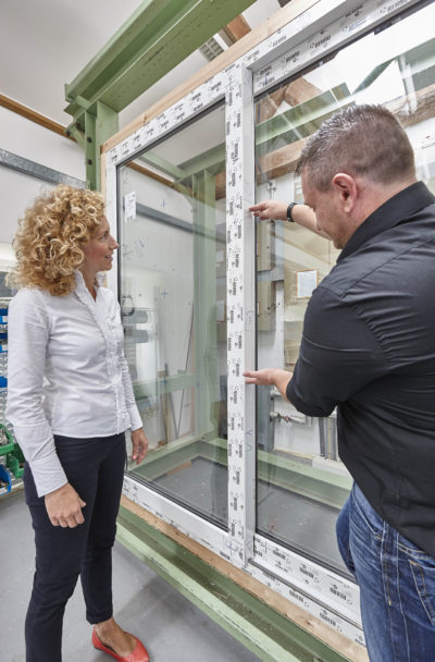 Product manager, Clare Higgins and technical applications engineer, Dean Franklin, with the PAS24 approved Rehau Agila door