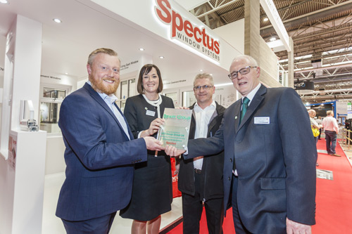 UCS's managing director, Mark Scullion, is presented with an award to mark 10 years partnership with Spectus at the FIT Show by Epwin Windows Systems' managing director, Clare O'Hara and sales director, Paul Lindsay