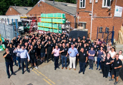 Centre front row: Ken Blackman (previous owner), Roy Frost (MD), Gary Bristow (sales director) and Mike Wolstenholme (operations director) outside the GJB factory