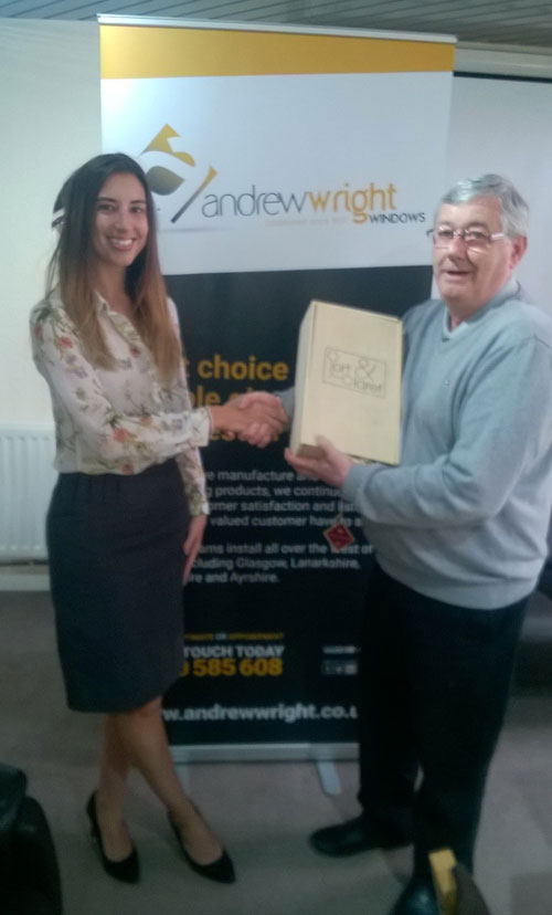 Veka Group's Amy Grundy presents Charlie Berry of Andrew Wright Windows with a gift to celebrate 80 years of trading.