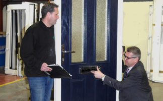Paul Briggs (R), MD of Watergate Flood Solutions inspects one of the new composite flood defence doors alongside Martin Porter (L), head of production.
