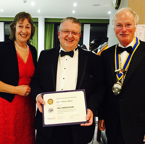 Paul Harris Fellowship recipient Ian Short (centre) with Scott Wolstenholme JP, president of The Rotary Club of Roundhay, and his wife Lynne.