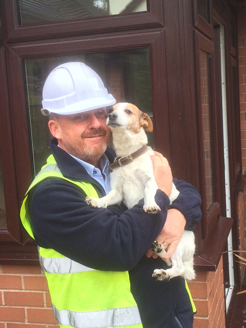 Guy Basnett, director of Target Windows with his rescue dog, Molly
