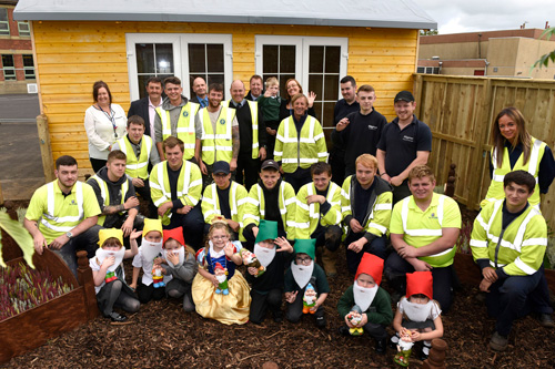 Pupils of Crosshouse Primary School join the team involved in the construction of the new 'Happy Hive', which will provide a calming sanctuary for young people with communications disorders and Autism.