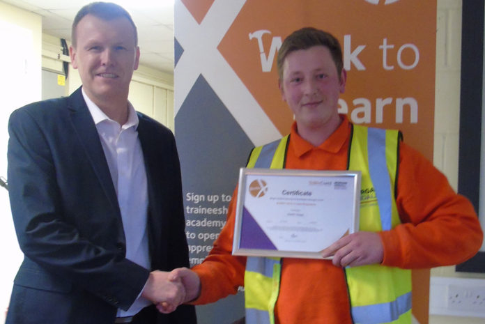 Mark Crane, commercial director at The Window Company (Contracts) pictured with a Basworx trainee at the end of the programme