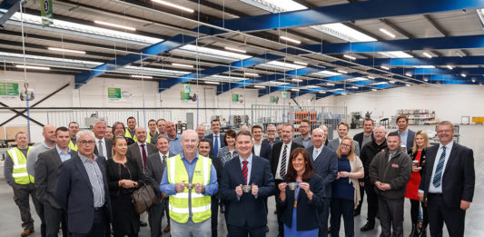 (Front, L-R) Marking the opening of the new CMS Trade factory in East Kilbride: Stuart Glen, CMS Trade Factory Manager; David Ritchie, CEO of CMS Window Systems; and Cllr Collette Stevenson, Depute Provost of South Lanarkshire Council.