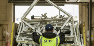 Inside the CMS recycling centre at Castlecary near Glasgow, where post-use windows and doors from CMS Trade customers are dismantled and separated to be sent for recycling rather than being consigned to landfill.