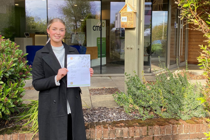 Amy Ledger, environmental advisor at CMS Group, with the John Muir Discovery Award which has been presented to the CMS EnviroChamps employee team in recognition of their work to enhance the wild spaces around its main Castlecary HQ and factory